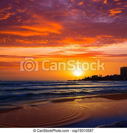 Javea El Arenal beach sunrise Mediterranean Spain - csp19310587