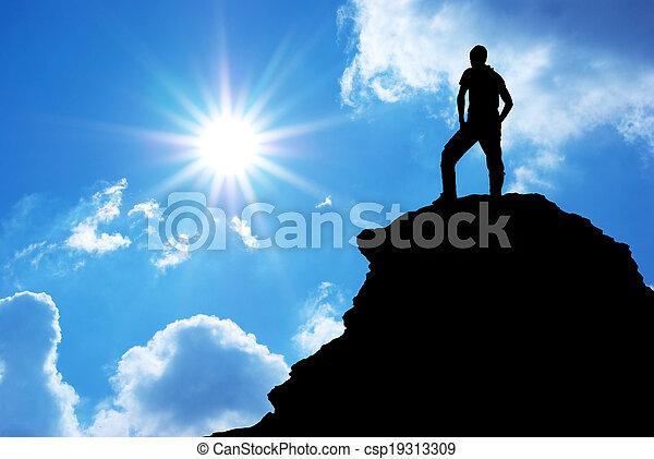 Man on top of mountain. - csp19313309