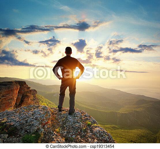 Man on top of mountain - csp19313454