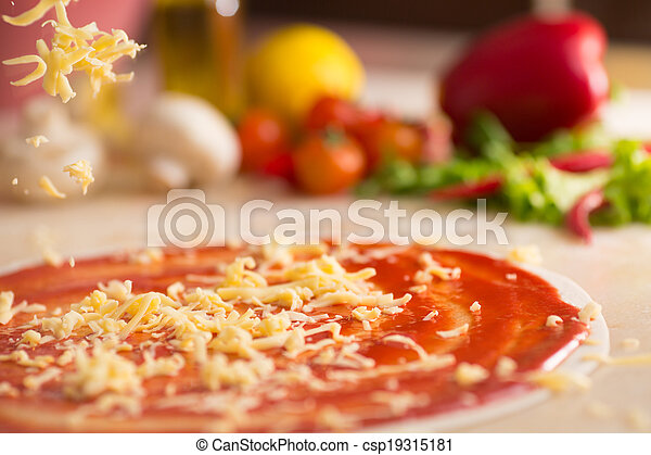 Italian pizza preparation with cheese falling. - csp19315181