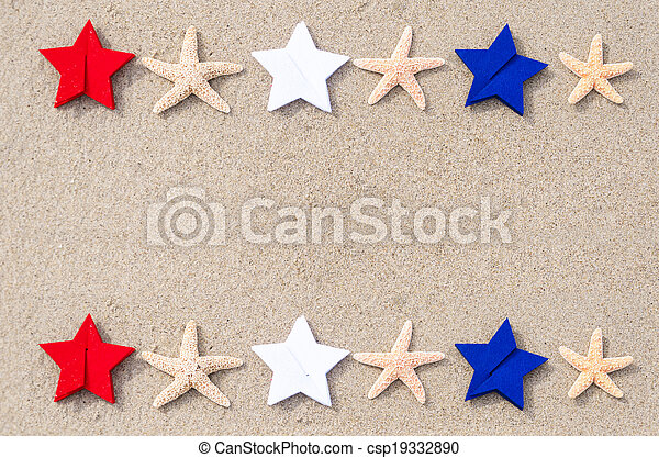 American holidays background with starfishes and color stars on the sand