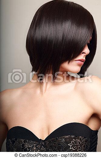 Beautiful sexy woman looking. Black short hair style. Closeup