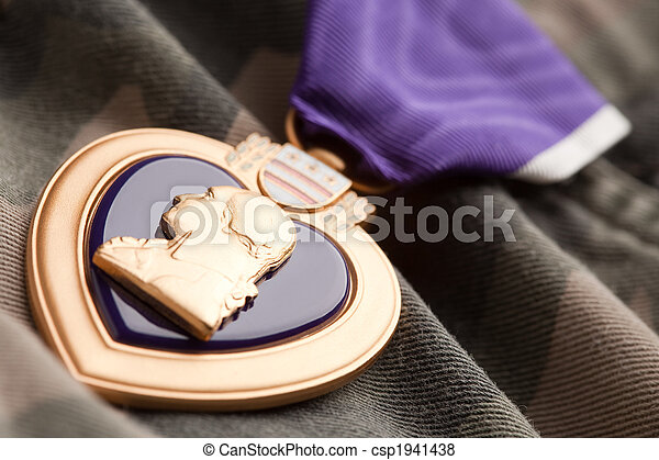 Purple Heart War Medal on Camouflage Material - csp1941438