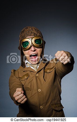 Funny pilot with goggles and helmet - csp19441925