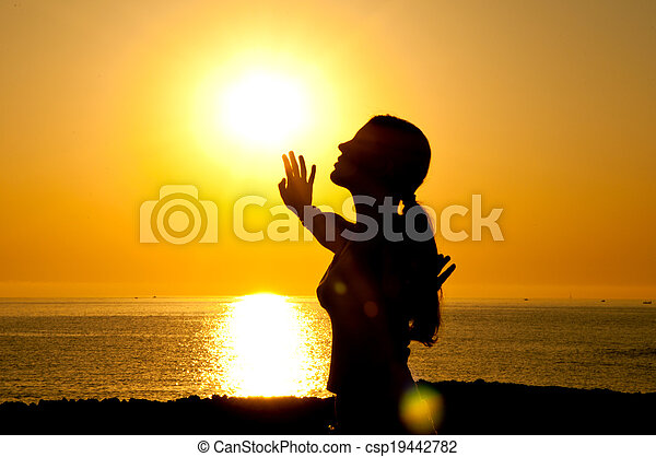 Woman silhouette in the sun - csp19442782