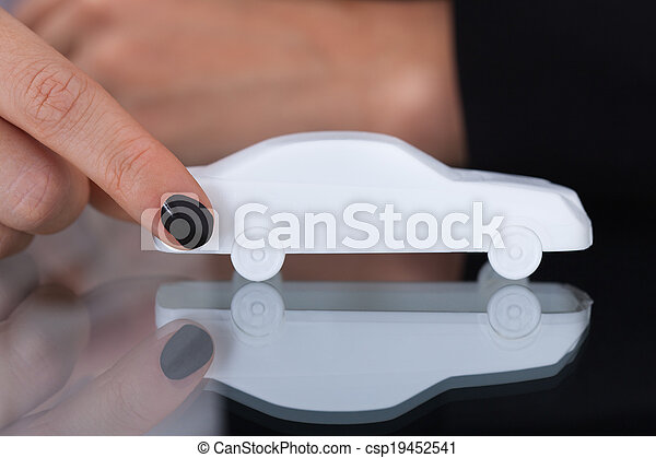 Businesswoman Holding Toy Car - csp19452541