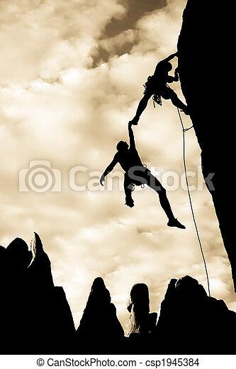 Team of climbers in danger. - csp1945384