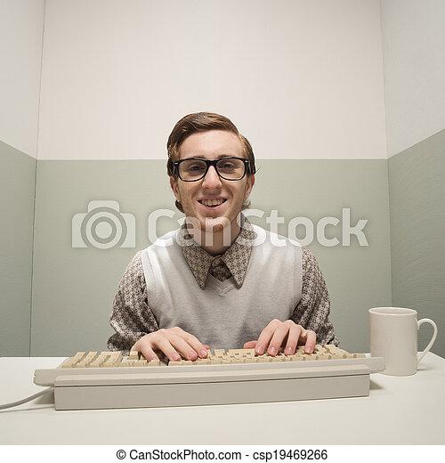 Vintage nerd on computer
