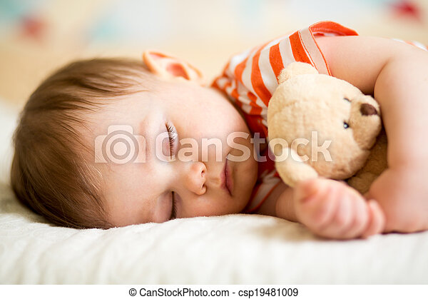 infant baby sleeping with plush toy - csp19481009