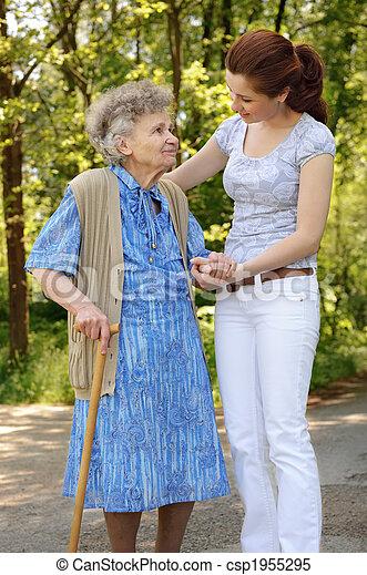 images de personne agee femme dehors personne agee femme marche csp1955295. Black Bedroom Furniture Sets. Home Design Ideas