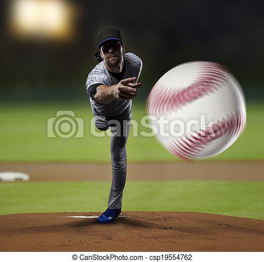 Pitcher Baseball Player on a Blue Uniform on baseball Stadium.