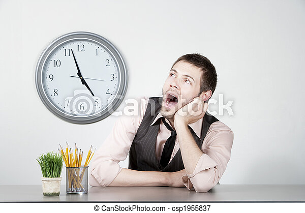 Young man bored at work - csp1955837