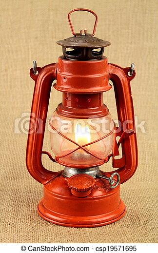 Red oil lamp on burlap