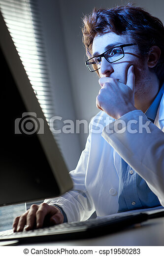 Researcher working at computer - csp19580283