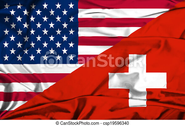 Waving flag of Switzerland and USA - csp19596340