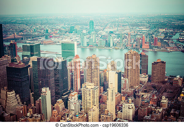 Aerial view of Manhattan skyline at sunset, New York City  - csp19606336