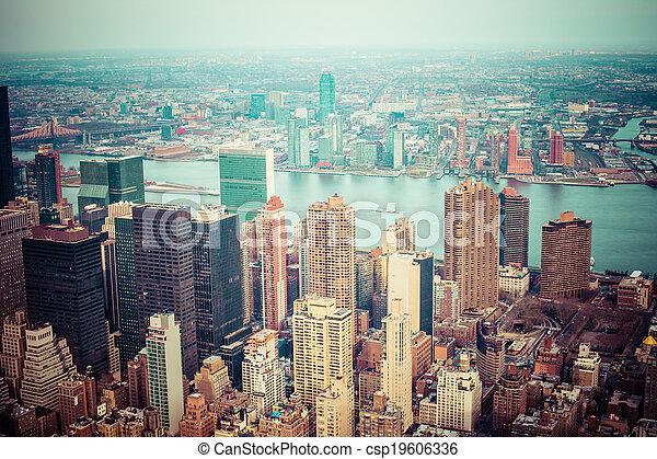 Aerial view of Manhattan skyline at sunset, New York City  - csp19606336