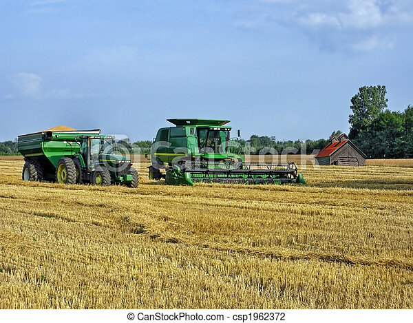 Stock Photo of Harvest Time - Modern farming equipment in ...
