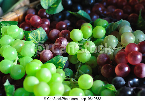 Many huddle color grapes fruit, green, red and black. - csp19649682