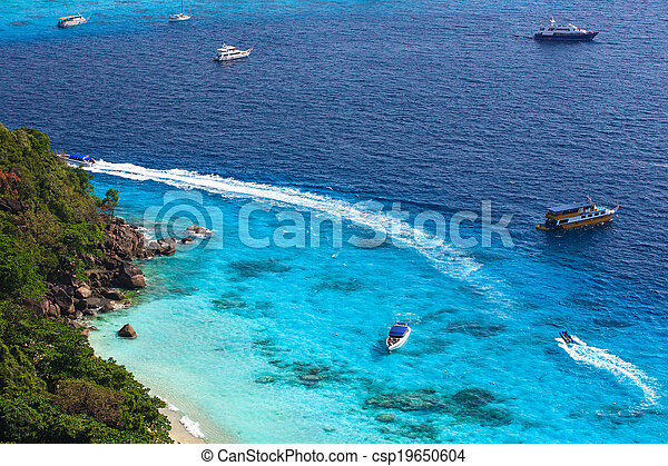 Aerial view of a beach with some motorboats - csp19650604