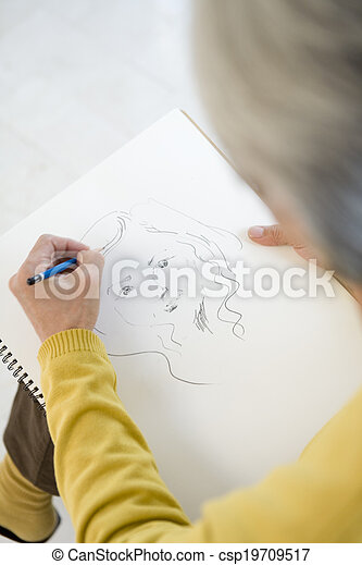 senior man drawing a picture