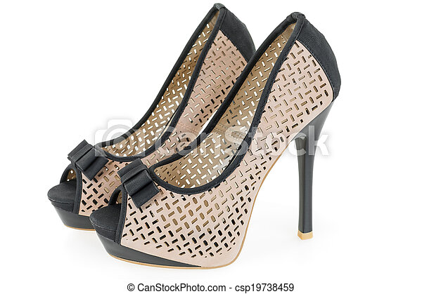 Pare of beige and black high hill shoes on white background - csp19738459