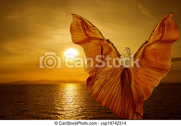 Woman with butterfly wings flying on fantasy sea sunset, relaxation meditation concept - csp19742314