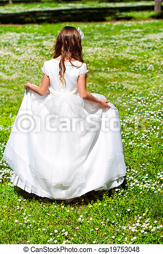 Girl walking in flower field. - csp19753048