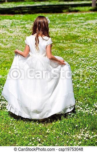 Girl walking in flower field. - csp19753048