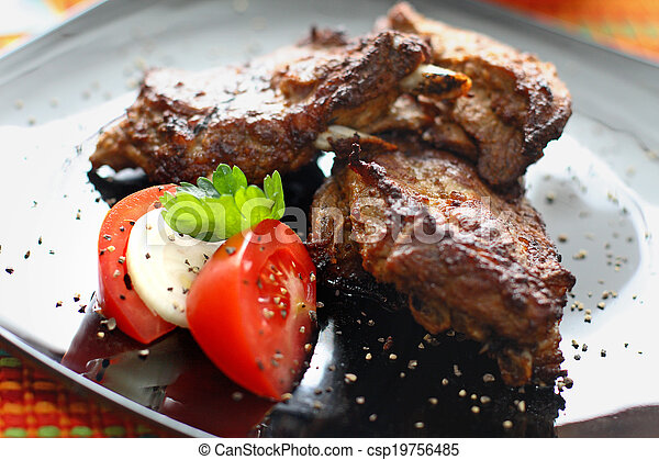 Grilled beef steak with tomatoes