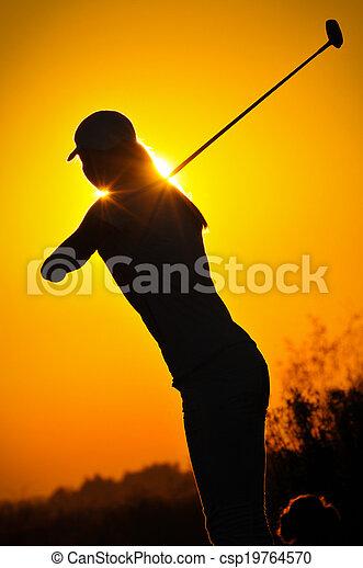 Female golfer at sunrise - csp19764570
