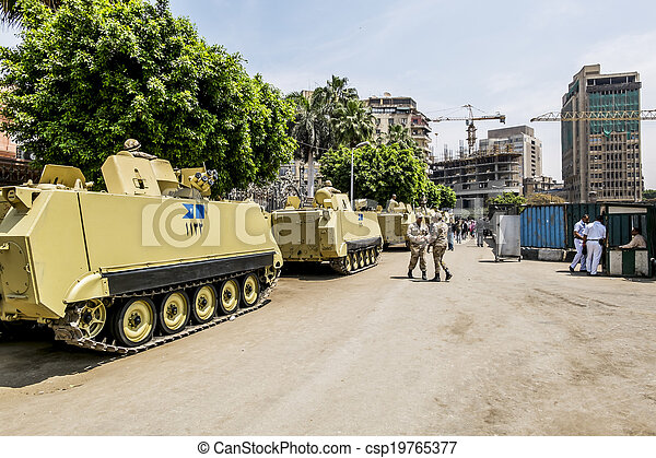 Armoured vehicles and soldiers in front of the burned-out buildings of the Government and the National Museum in Cairo, April 13, 2014,Egypt - csp19765377