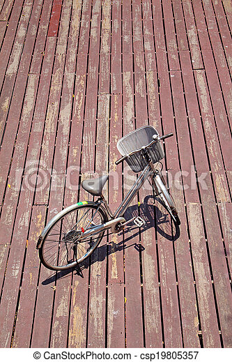 The bicycle on wooden background - csp19805357