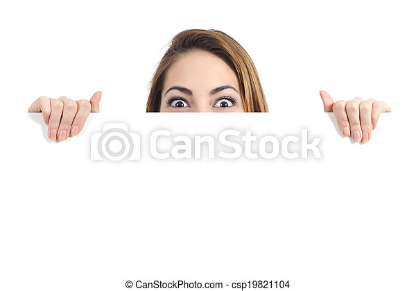 Surprised woman eyes over a blank promotional display - csp19821104