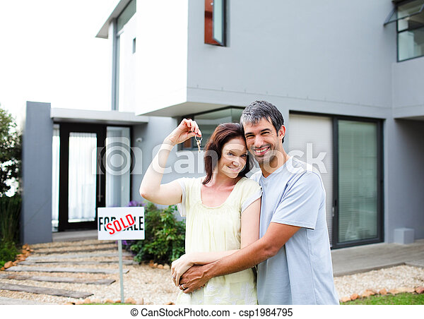 Happy couple after buying house - csp1984795