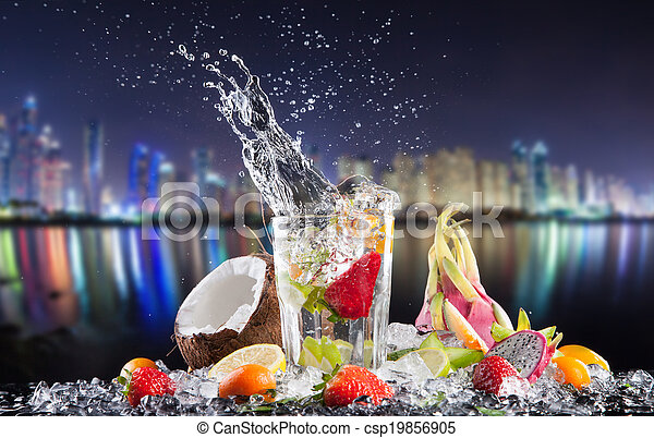Summer exotic drinks with splash at night city - csp19856905