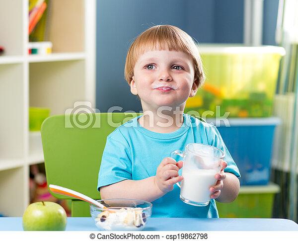 kid boy drinking milk