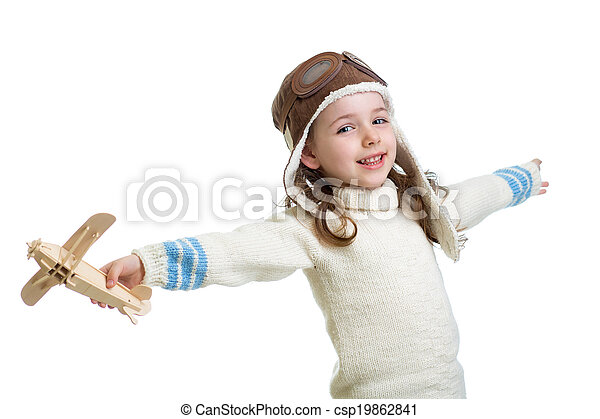 kid dressed as pilot and playing with wooden airplane toy isolated on white background - csp19862841