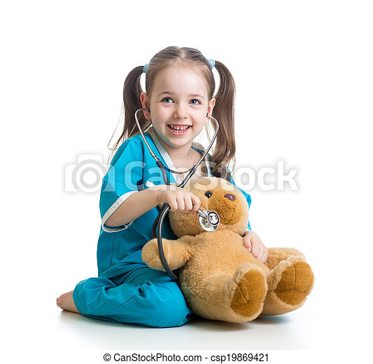 Adorable child with clothes of doctor examining teddy bear toy over white - csp19869421