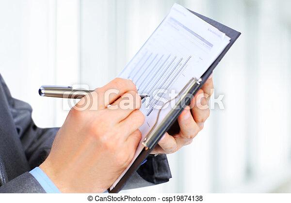 Businessman writing something