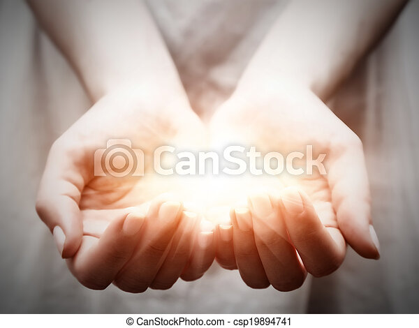 The light in young woman hands. Sharing, giving, offering, protection - csp19894741