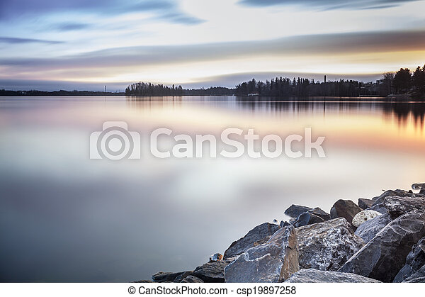 Beautiful lake coast during sunrise - csp19897258