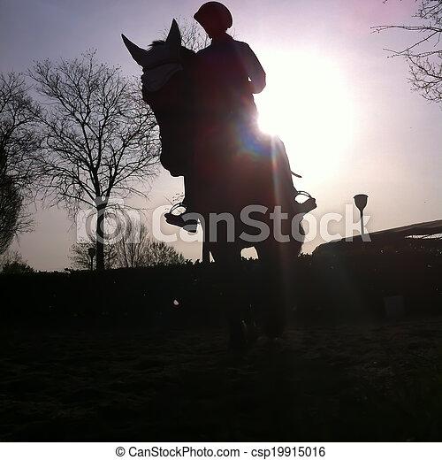 Riding at sunset - csp19915016