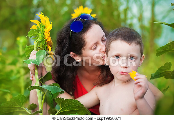 Mother and son in field in summer