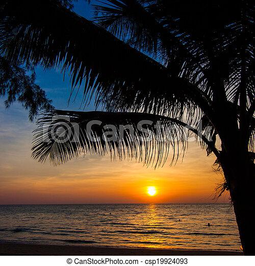 Beautiful sunset at a beach resort in tropics - csp19924093
