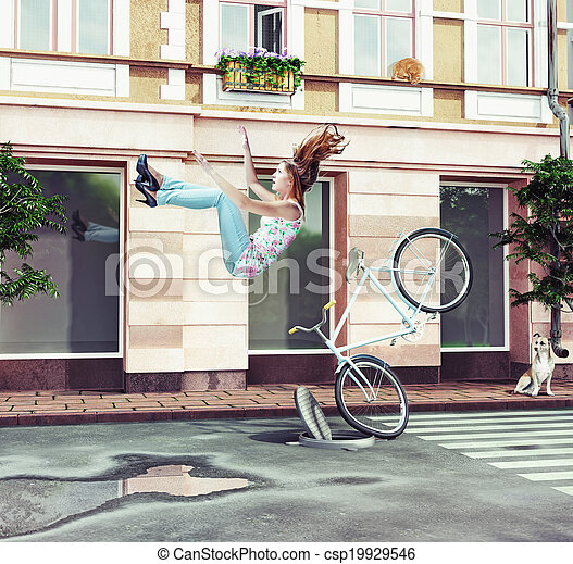 girl falling off her bicycle - csp19929546