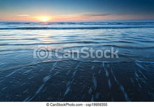 sunset over North sea waves - csp19959355