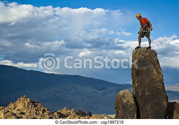 Rock climber nearing the summit. - csp1997216