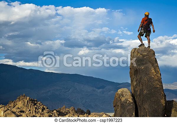 Rock climber nearing the summit. - csp1997223