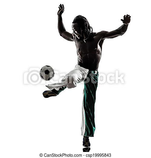 black man soccer player juggling football silhouette - csp19995843